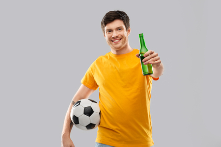 man or football fan with soccer ball and beer Banco de Imagens