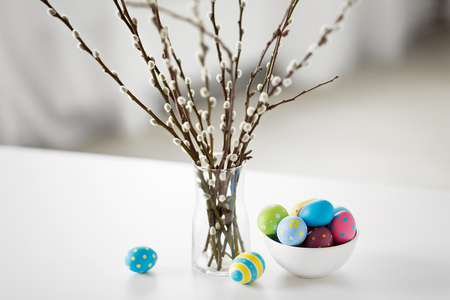 pussy willow branches and colored easter eggs