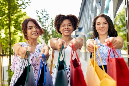 happy women with shopping bags in city Stock fotó - 118986580