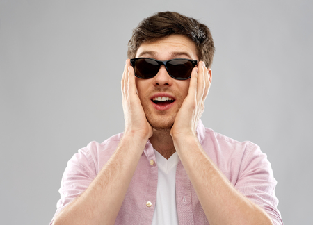 amazed young man in black sunglasses