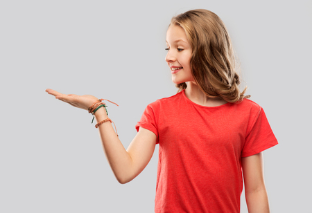 smiling teenage girl holding empty hand