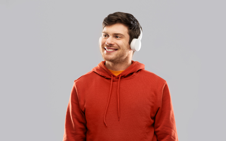 happy young man in headphones and red hoodie Archivio Fotografico