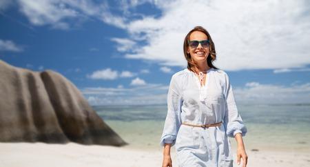 happy woman over seychelles island tropical beach Stock Photo