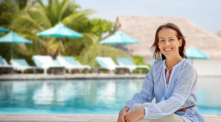 happy woman over swimming pool of touristic resort Stock Photo