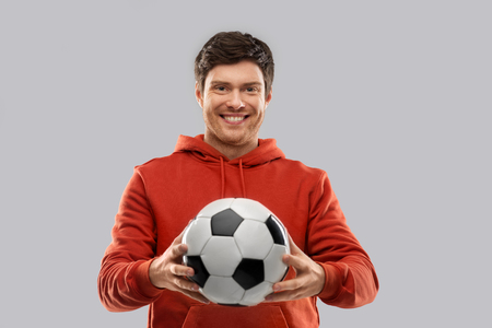 happy man or football fan with soccer ball