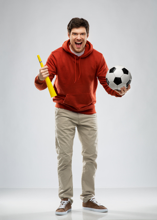 man or football fan with soccer ball and vuvuzela