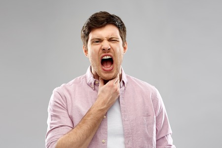 screaming man suffering from sore throat Stock Photo