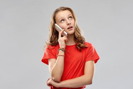 bored teenage girl calling on smartphone Imagens