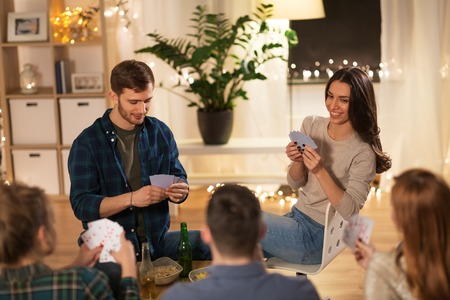 friends playing cards game at home in evening Imagens - 119010934