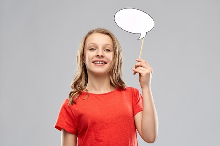 smiling teenage girl holding blank speech bubble