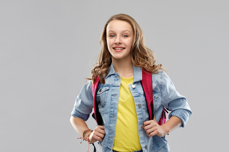 happy smiling teenage student girl with school bag Imagens - 119079313