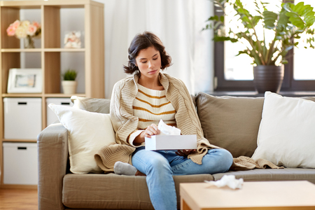 sick woman taking paper tissue from box at home Imagens - 119079322