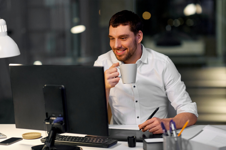 designer with computer and pen tablet at office Imagens
