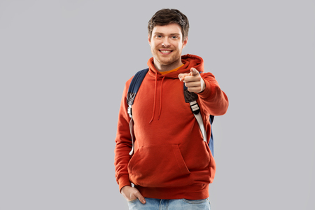 young man or student with school bag or backpack