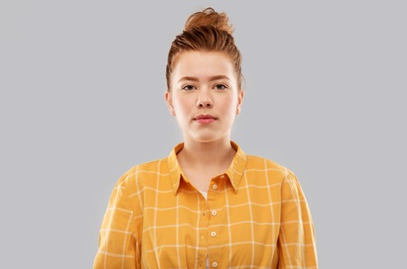 red haired teenage girl in checkered shirt