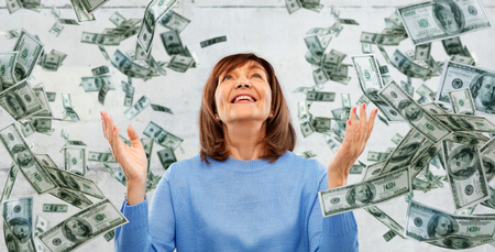 grateful senior woman and money falling from above