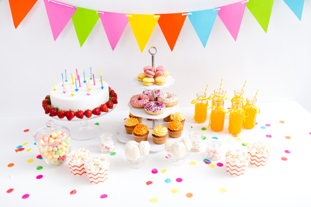 food and drinks on table at birthday party