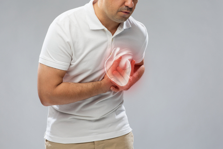 close up of man having heart attack or heartache