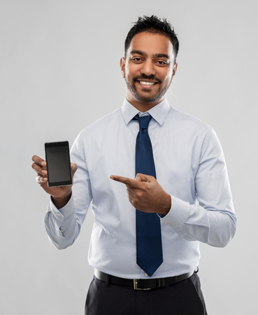 indian businessman with smartphone