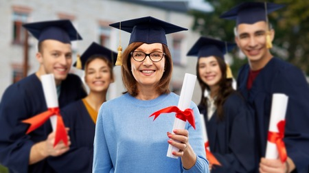 happy senior graduate student woman with diploma