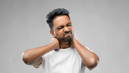 tired indian man suffering from neck pain Stock Photo - 119434390