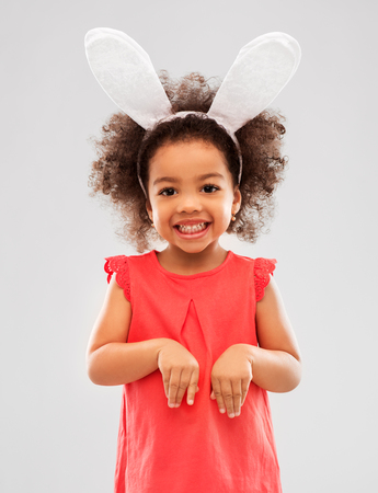 happy little girl wearing easter bunny ears