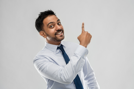 indian businessman pointing finger at something