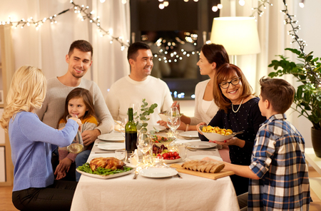 celebration, holidays and people concept - happy family having dinner party at home Stockfoto