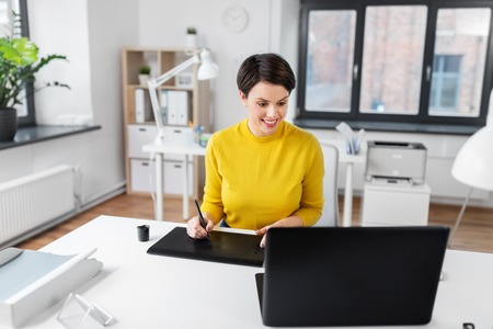 Designer with computer and pen tablet at office