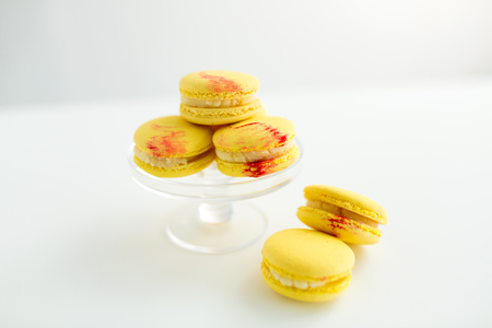 lemon yellow macarons on glass confectionery stand