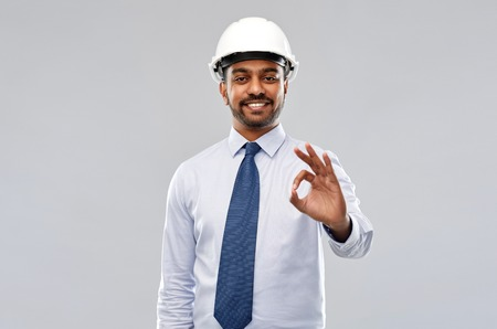 architect or businessman in helmet showing ok