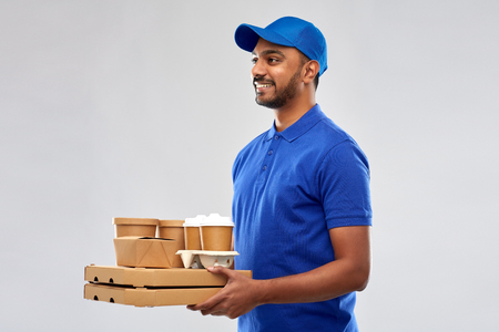 happy indian delivery man with food and drinks 免版税图像 - 119714917