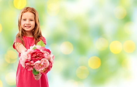 happy red haired girl with flowers