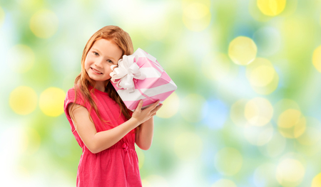 lovely red haired girl with birthday gift