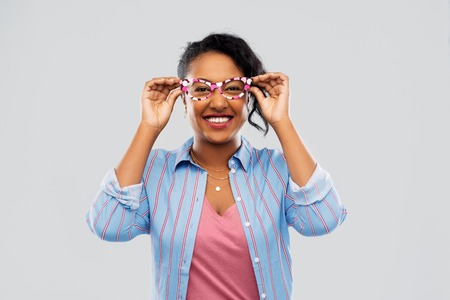 happy african american woman with big glasses Banco de Imagens