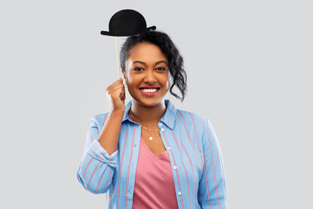 african woman with bowler hat party accessory