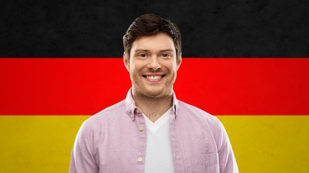 smiling young man over german flag colors Фото со стока