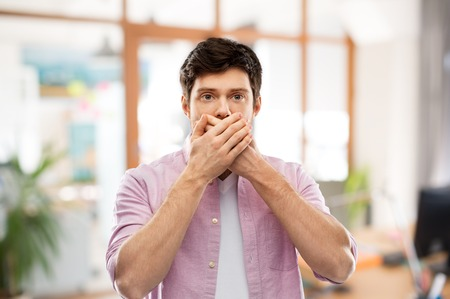 shocked man closing mouth by hands at office room Stock Photo - 120057816