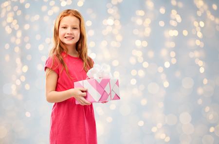 smiling red haired girl with birthday gift