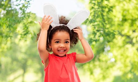 happy little girl wearing easter bunny ears