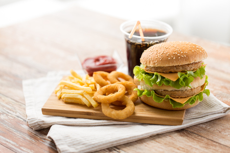 close up of fast food and cola drink on table