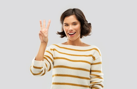 happy smiling woman showing three fingers