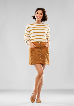young woman in striped pullover, skirt and shoes