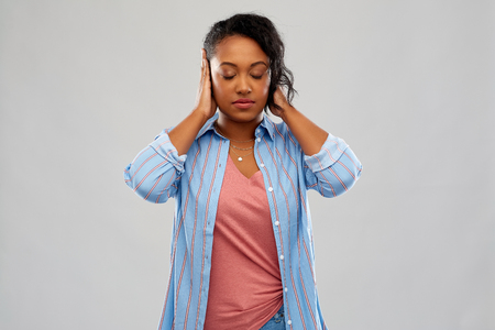 african american woman closing ears by hands Imagens