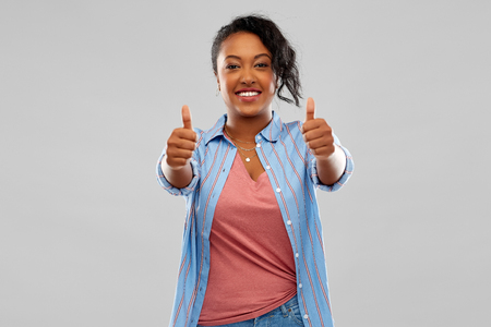 happy african american woman showing thumbs up Stock Photo - 120496942