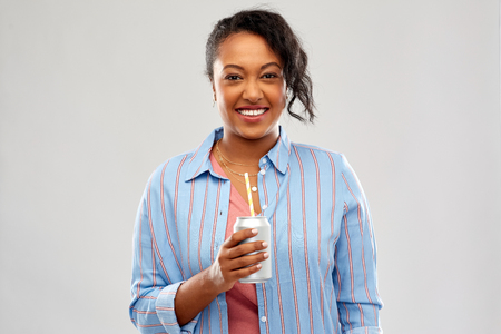 happy african american woman with can drink Stock Photo