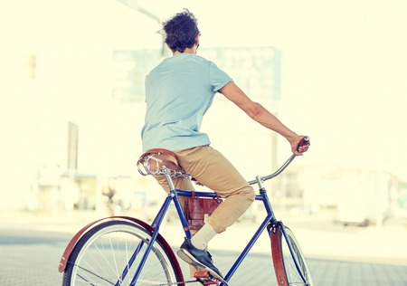 hipster man riding fixed gear bike Imagens