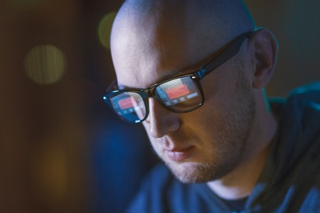 hacker with access denied reflecting in glasses
