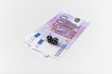 close up of black dice and euro money 写真素材