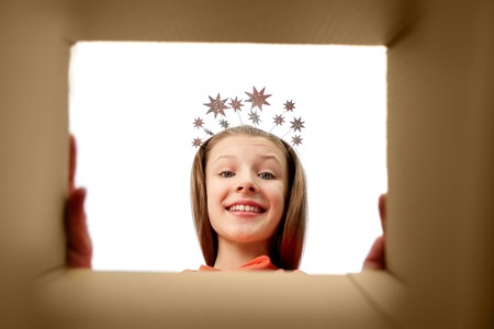 happy girl in tiara looking into open gift box 版權商用圖片